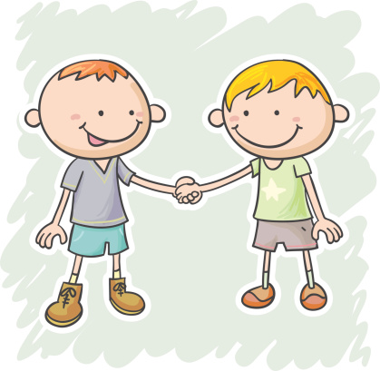 Two little boys are holding hands