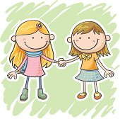 Two little girls are holding hands