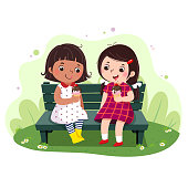 Vector illustration of  two little girls eating ice cream on the bench.