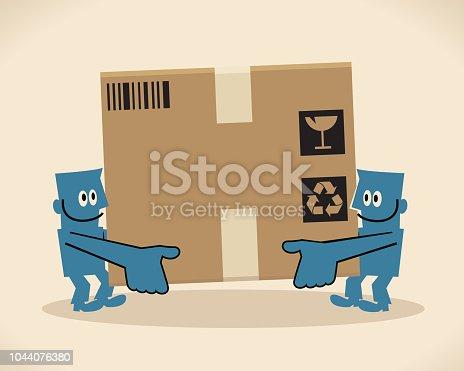 istock Two men carrying a big cardboard box 1044076380