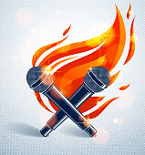Two microphones crossed on fire, hot mic in flames, rap battle rhymes music, karaoke singing, vector illustration, concert festival or night club label, t-shirt print.