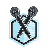 Two microphones vector logo or emblem isolated on white, MC rapper or rap battle concept, stand up comic or radio, blogger.