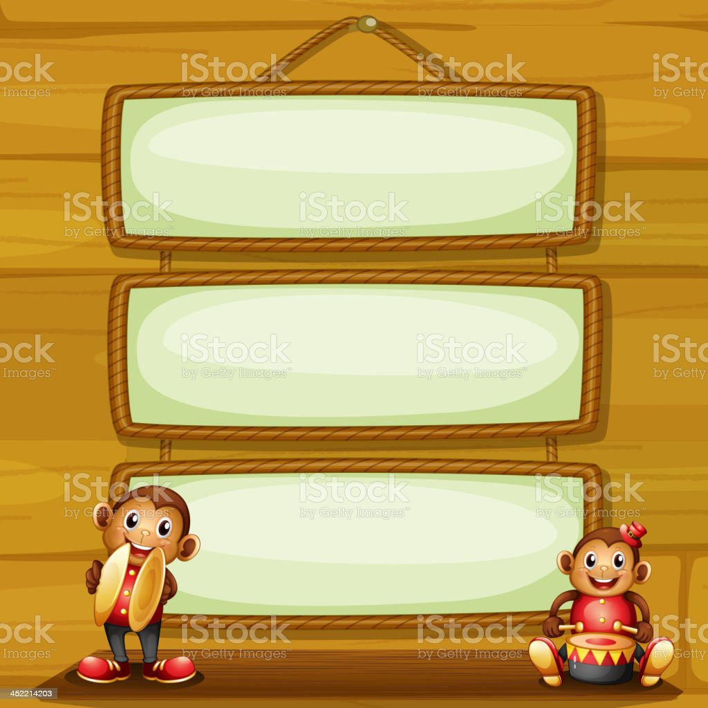 Two musical monkeys in front of the hanging signboards
