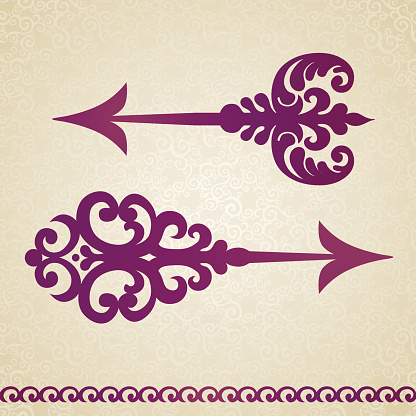 Two ornate decorated vector arrows in Victorian style.