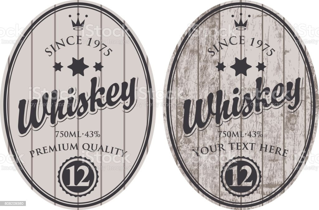 two oval labels for whiskey on wooden background vector art illustration