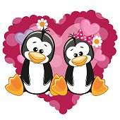 Two Penguins on a background of heart