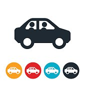 An icon of two people in a car. The icons symbolizes carpooling or riding together.