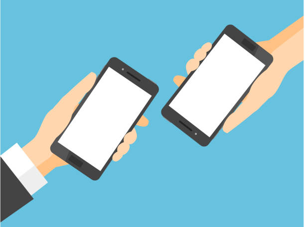 Two smartphones with blank white screen Two smartphones with blank white screen. hand holding phone stock illustrations