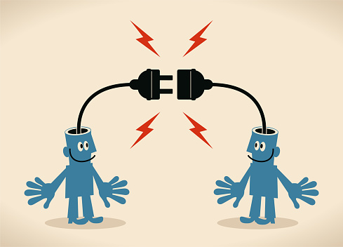Two smiling blue men with electrical plug and socket plugging in each other