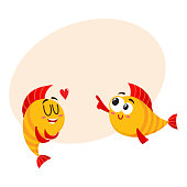 Two funny, smiling golden fish characters, one showing love, another pointing with fin, cartoon vector illustration with place for text. Yellow fish characters, mascots, love and laughing