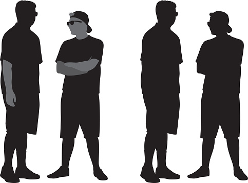 Two Teenagers Standing Silhouettes