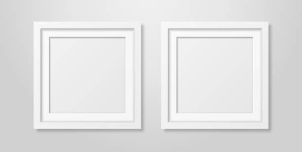 illustrazioni stock, clip art, cartoni animati e icone di tendenza di due vettori realistici interni moderni bianco bianco bianco quadrato in legno cornice cornice mock-up set primo piano su parete bianca. modello di progettazione cornici poster vuote per mockup, presentazione, immagine o testo - intelaiatura