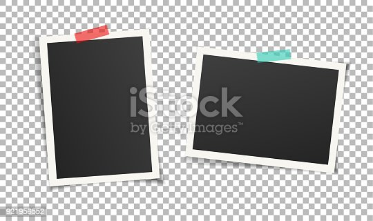 istock Two vintage photo frames with adhesive tape on transparent background. 921956552
