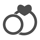 istock Two wedding rings solid icon. Couple engagement ring with heart shape symbol, glyph style pictogram on white background. Valentine day sign for mobile concept, web design. Vector graphics. 1216072952