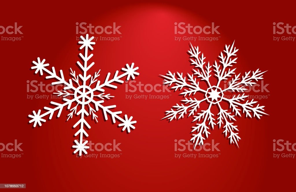 Two white vector snow flakes of different shapes on red background - Векторная графика 2019 роялти-фри