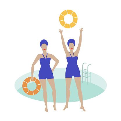 Two women by the swimming pool with swim rings. Blue retro swimwear and swim caps.