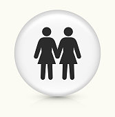 Two Woman Love Each Other.The icon is white and is placed on a round vector button. The button is light in color and the background is light as well. The composition is simple and elegant. There is a small shadow under the button. The vector icon is the most prominent part if this illustration.