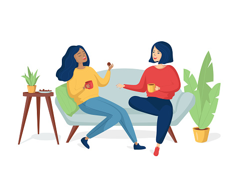 Two young happy cheerful women are sitting on the couch and laughing. Girlfriends drink tea with cookies. A same-sex family spends time together.Two sisters are talking and smiling.Vector illustration
