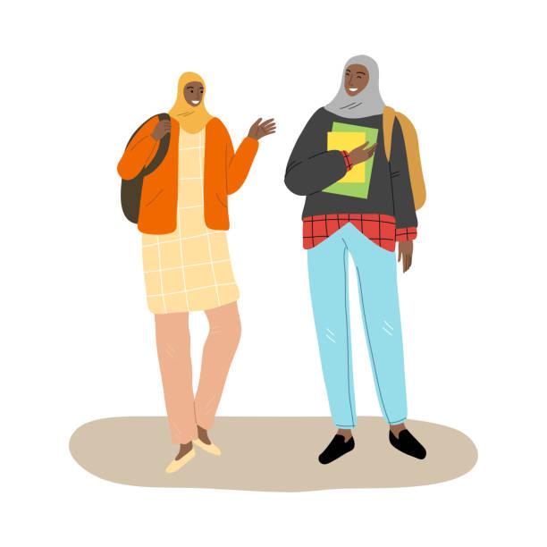 zwei junge lächelnde muslimische mädchen freunde mit rucksäcken hoing von der schule zusammen - nur erwachsene stock-grafiken, -clipart, -cartoons und -symbole
