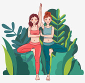 Two young women practicing yoga. Summer landscape background