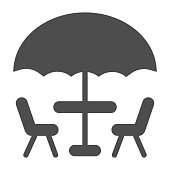 istock Umbrella and table with chairs solid icon, Coffee time concept, street cafe sign on white background, table with umbrella for terrace icon in glyph style for mobile, web. Vector graphics. 1263985334