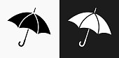 Umbrella Icon on Black and White Vector Backgrounds. This vector illustration includes two variations of the icon one in black on a light background on the left and another version in white on a dark background positioned on the right. The vector icon is simple yet elegant and can be used in a variety of ways including website or mobile application icon. This royalty free image is 100% vector based and all design elements can be scaled to any size.