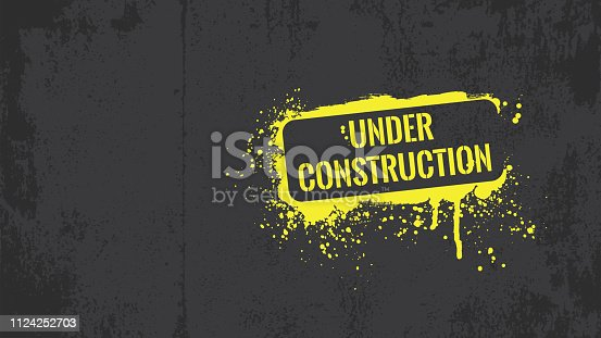 Yellow under construction graffiti on a black grunge background