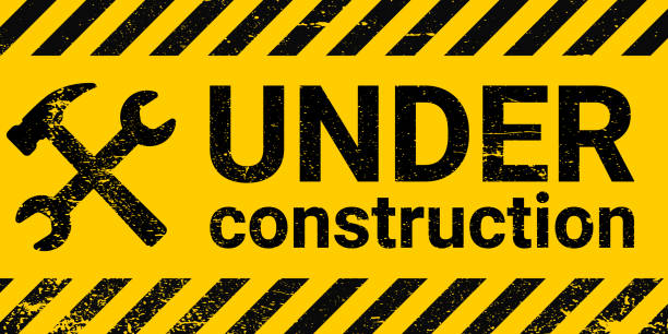 under construction site banner sign vector black and yellow diagonal stripes under construction, hammer and wrench repair sign with grunge texture under construction site banner sign, vector black and yellow diagonal stripes under construction, hammer and wrench repair sign with grunge texture construction site stock illustrations