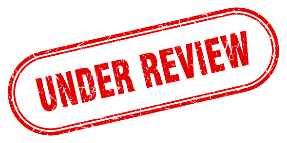under review stamp. rounded grunge textured sign. Label