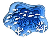 Underwater sea paper cut. Ocean bottom reefs with sea animals, corals and fish, seaweed. Blue seabed paper origami vector background