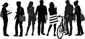 A vector silhouette illustration of a group of teenagers after school. A young girl looks in a book while her boyfriend listens, while another girl texts on her phone while a boy stands by his bike.  A couple hold hands.