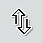 istock Up and down transfer arrows. Icon sticker on gray background 1309788864