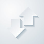 istock Up and down transfer arrows. Icon with paper cut effect on blank background 1317648736
