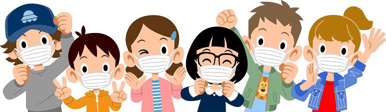 Upper body of energetic children wearing masks