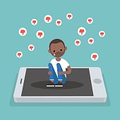 Upset crying black character sitting on the mobile's screen and hugging his knees surrounded by the dislike symbols / editable flat vector illustration, clip art