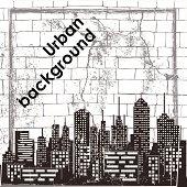 City skyline against old brick wall