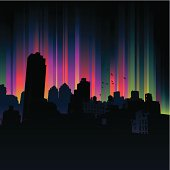 Silhouetted urban scene with bright multi coloured background.