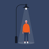 Urban scene. Young male character standing under the light of a lantern. Conceptual flat illustration, clip art