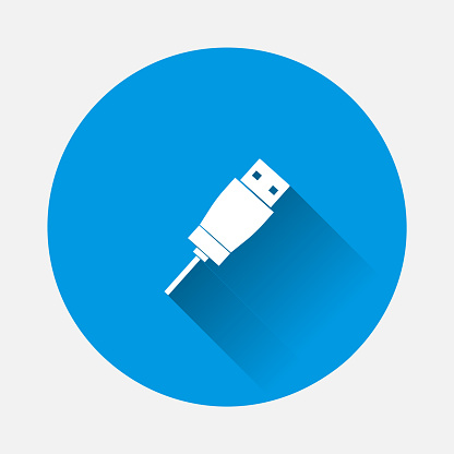 Usb cable icon on blue background. Flat image with long shadow.