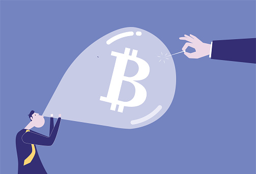 Using a needle to pierce the Bitcoin balloon blown by a businessman, a bubble economy