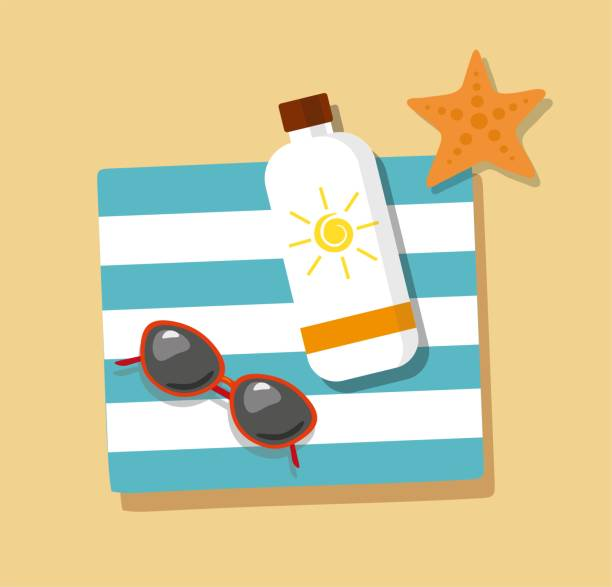 vacation. flip- flops in the sand with towel, sunglasses and cream from tan - sun cream stock illustrations