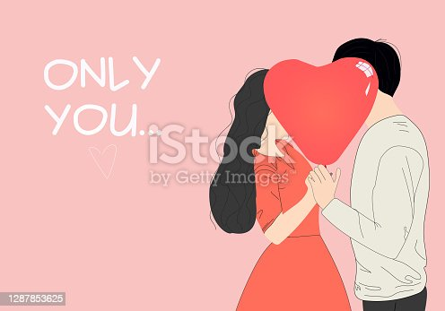 istock Valentine asian couple. Beauty girl and her handsome boyfriend holding a heart-shaped balloon and kissing. 1287853625