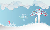 Valentine day , Concept two enamored beside the bicycle and tree with blue background,paper art and craft style.vector illustration.