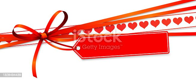 istock valentine ribbon bow with hearts and hang tag 1328494439