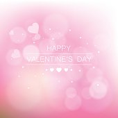 Vector background with beautiful pink hearts. Greeting card for Valentine's Day. Valentine's day background with hearts. Romantic shiny blurred vector background.