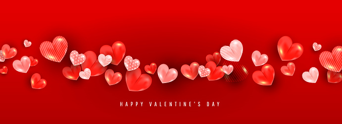 Valentines day background with 3D volumetric balloon hearts of different sizes and patterns on a red background with place for text.