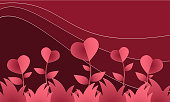 Valentines Day background with red paper heart cut, flower field with heart shaped on red mountain and red sky background. Concept of love and valentine day, paper art style.