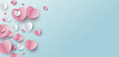 Valentines day banner design of paper hearts on blue background with copy space vector illustration