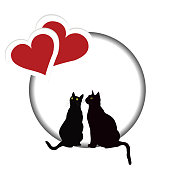 Valentines day card with two black cats and two red hearts
