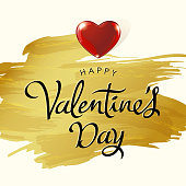 Celebrate Valentine's Day with red shiny heart on gold colored painted brush background